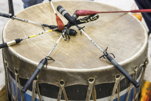 Indian drum and drum sticks placed in a symbolic manner after the drummers complete their song at a Native American pow-wow.